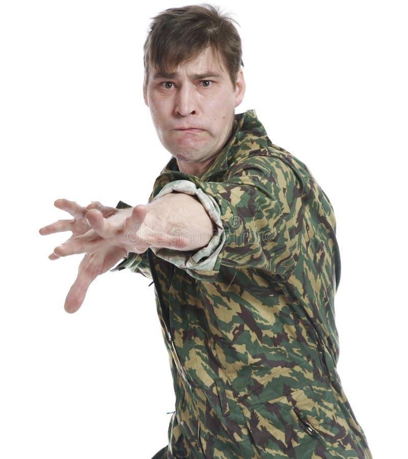 Um homem no vestido das forças armadas fotografia de stock royalty free