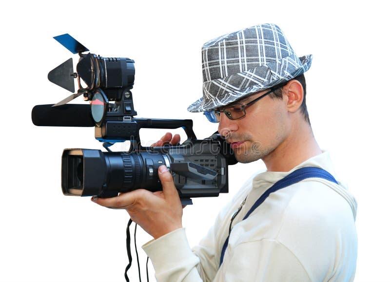 Um homem novo com uma câmara de vídeo fotos de stock royalty free
