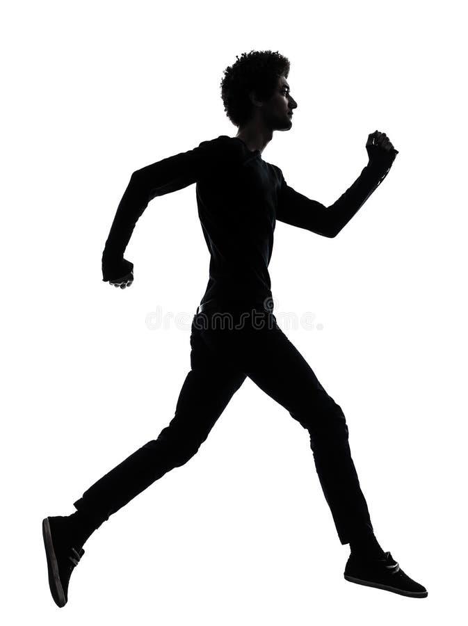 Silhueta running africana considerável do homem novo imagens de stock