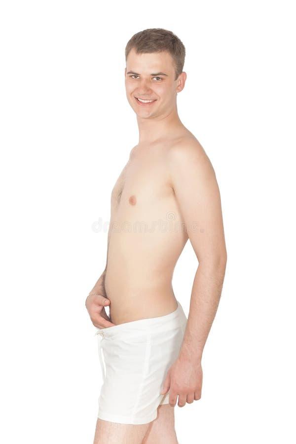 Um homem novo no short fotos de stock