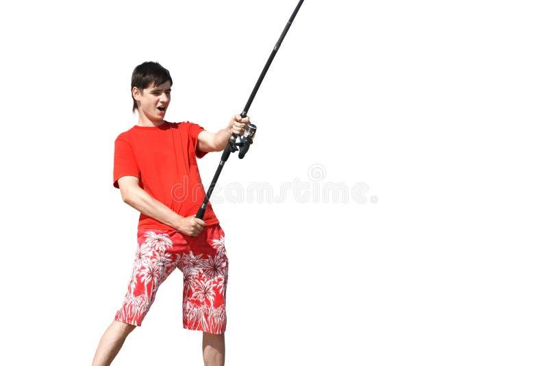 Um homem novo nos shorts e um t-shirt com fotografia de stock royalty free