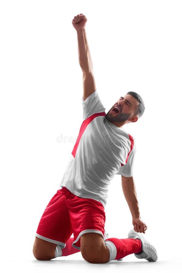 Um jogador de futebol profissional comemora a vitória Celebração feliz Isolado no fundo branco fotos de stock royalty free