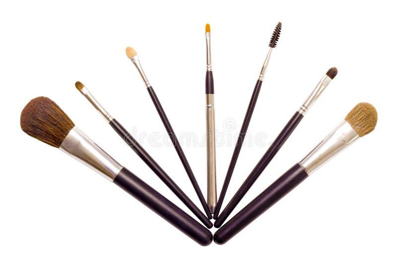 Um jogo das escovas para aplicar a composição foto de stock royalty free