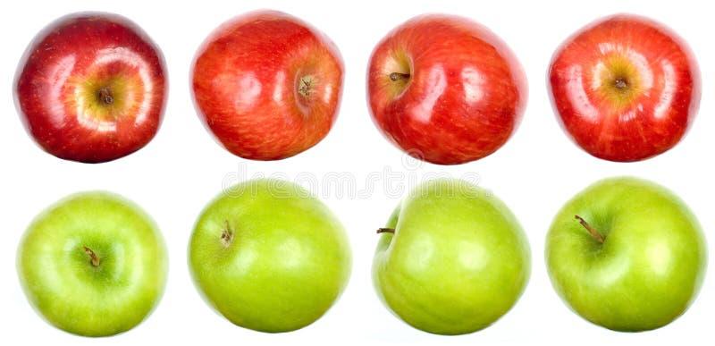 Um jogo das maçãs no branco imagem de stock royalty free