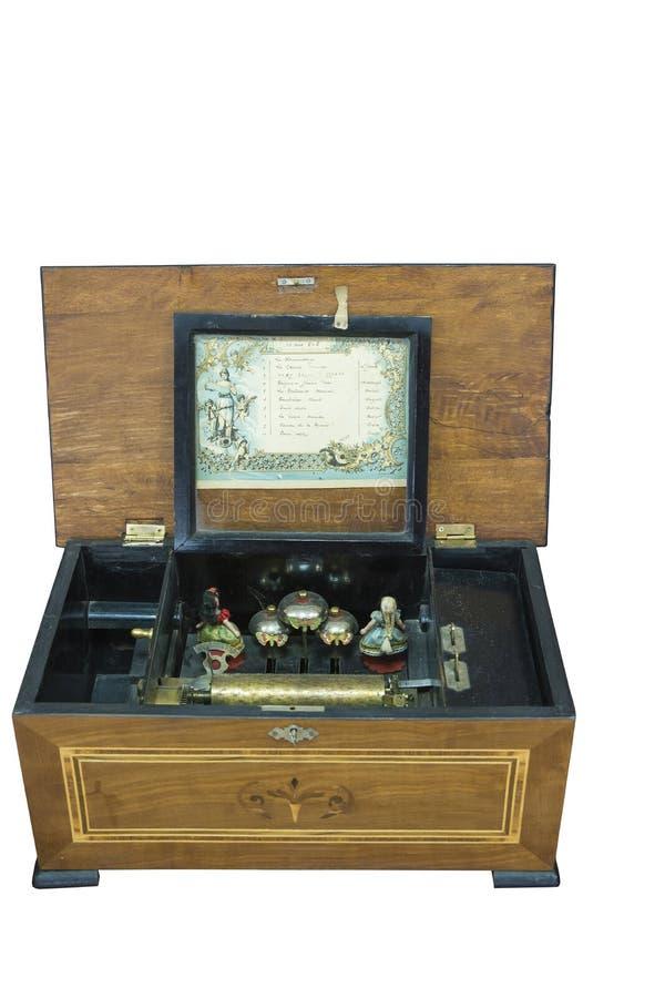 Um jukebox do século XIX do vintage em uma caixa de madeira em um fundo branco imagem de stock royalty free