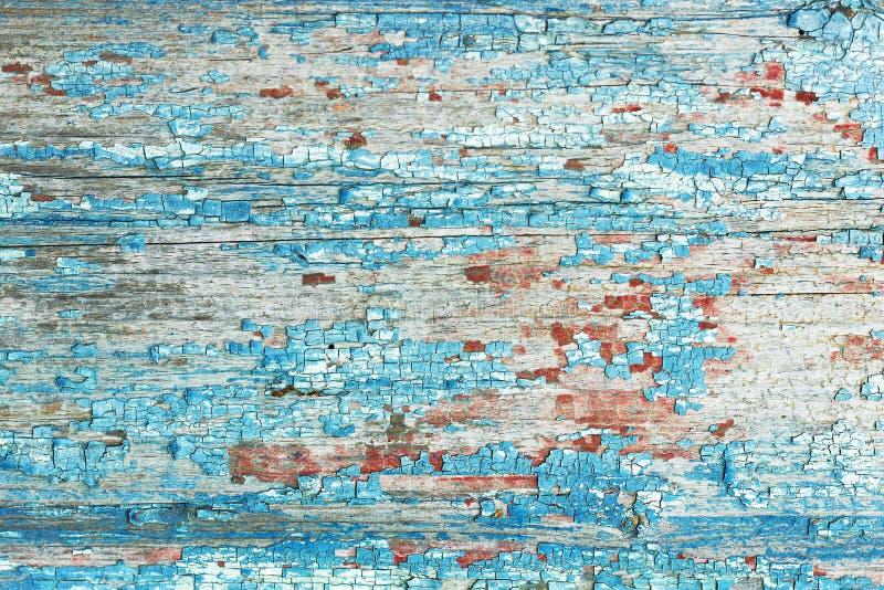 Um lindo padrão abstrato de parede de madeira velha pintada em vermelho e azul, textura de fundo imagens de stock