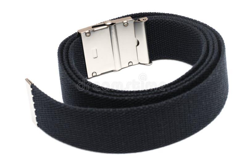 Um loop de cinta azul com fivela de metal contra um pano de fundo branco imagens de stock royalty free