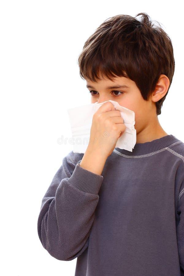 Um menino com frio fotografia de stock royalty free