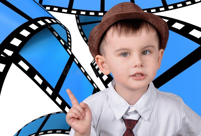 Um menino em um fundo dos quadros foto de stock royalty free