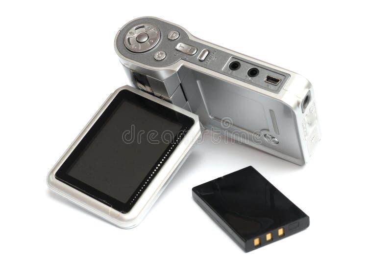 Um modelo mais velho de uma came acessível com sua bateria de íon de lítio de trabalho fotografia de stock
