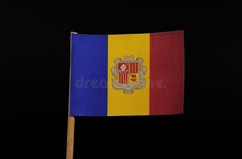 Um oficial e uma bandeira nacional do principado de Andorra no palito no fundo preto Um vertical tricolour de azul, amarelo fotografia de stock royalty free