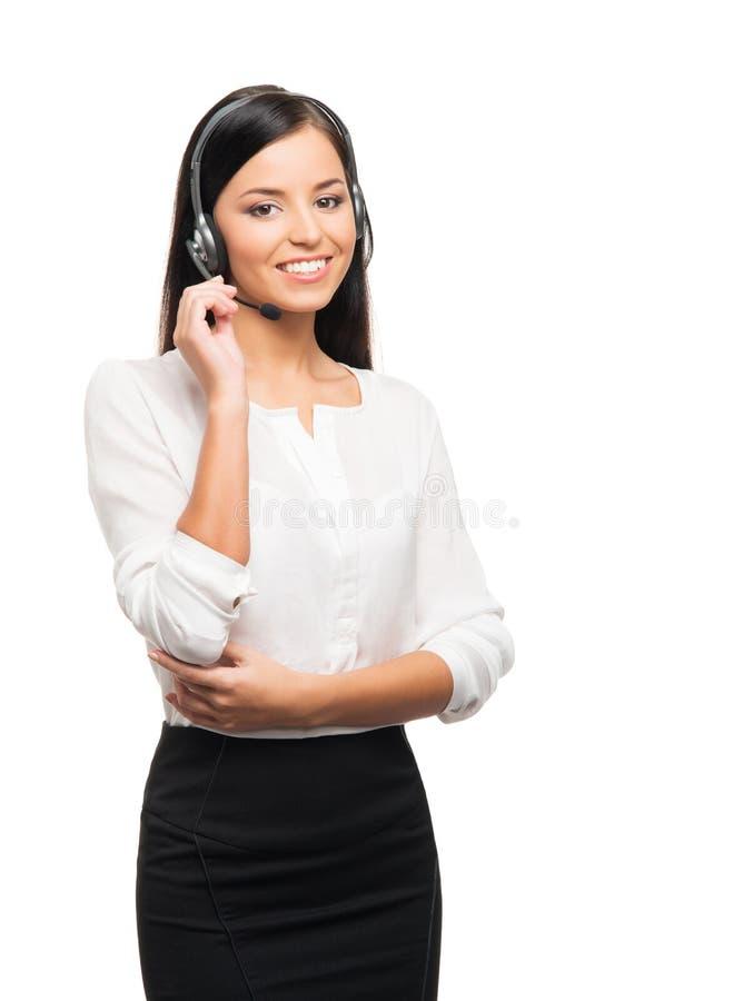 Um operador seguro e bonito do apoio ao cliente com fones de ouvido fotografia de stock