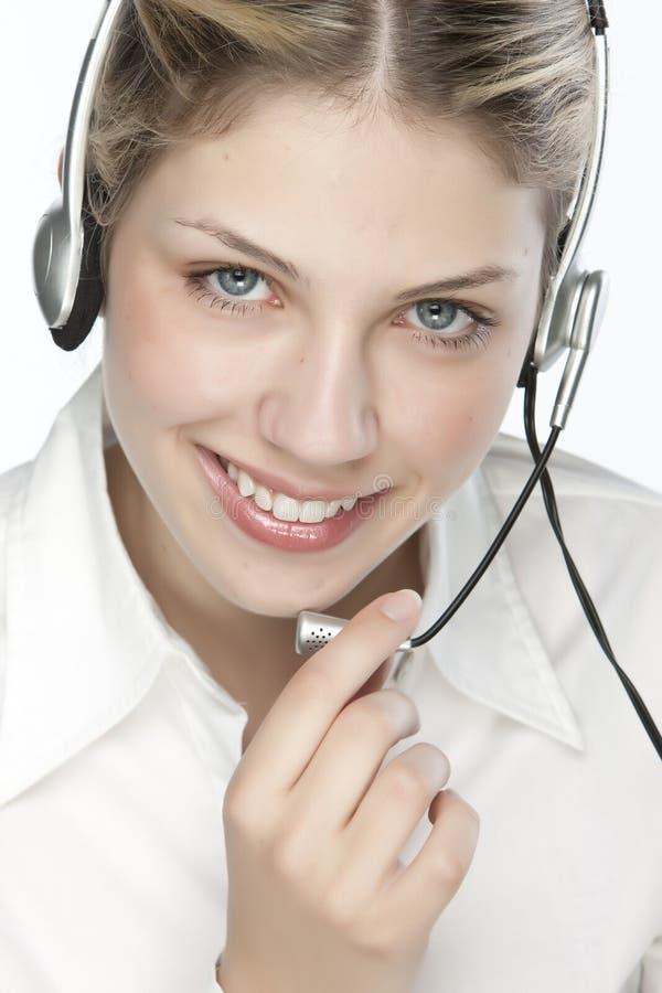Um operato amigável da secretária/telefone imagem de stock