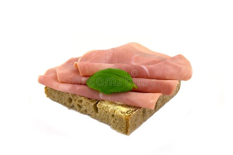 Um pão coberto com presunto fotografia de stock royalty free