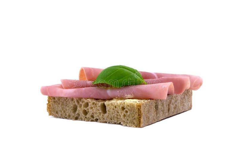 Um pão coberto com presunto foto de stock royalty free