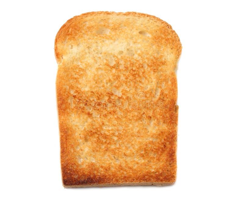 um pão cortado do brinde isolado no fundo branco fotografia de stock