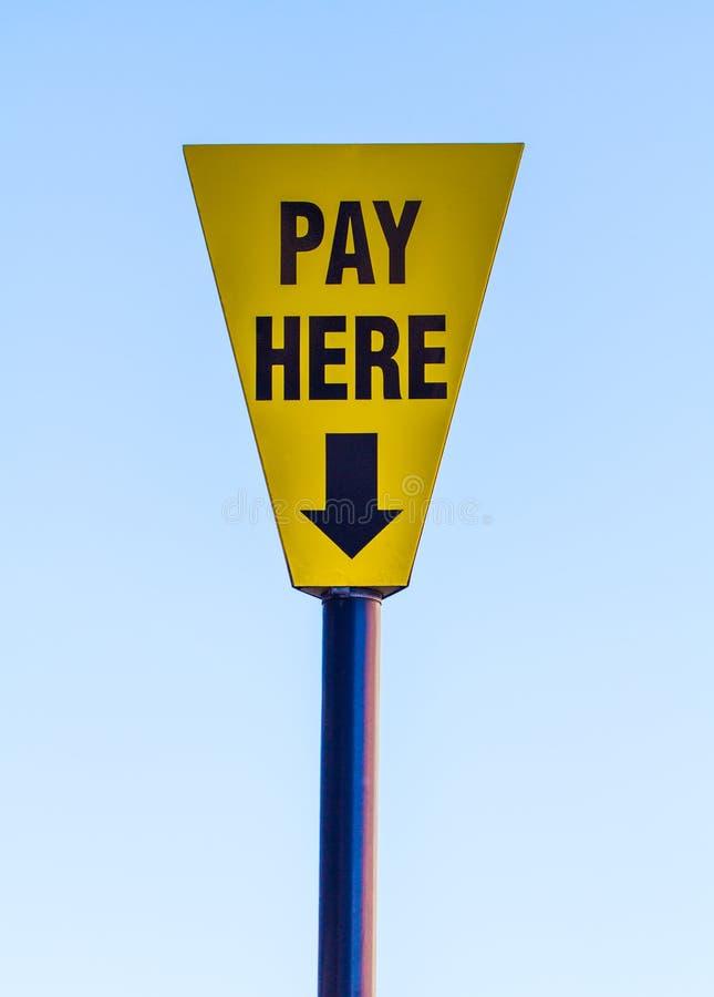 Um pagamento aqui assina fotos de stock royalty free