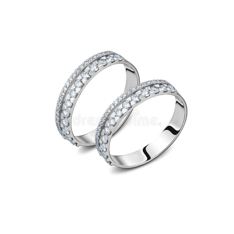 Um par de anéis de ouro branco luxuosos com os diamantes isolados fotos de stock