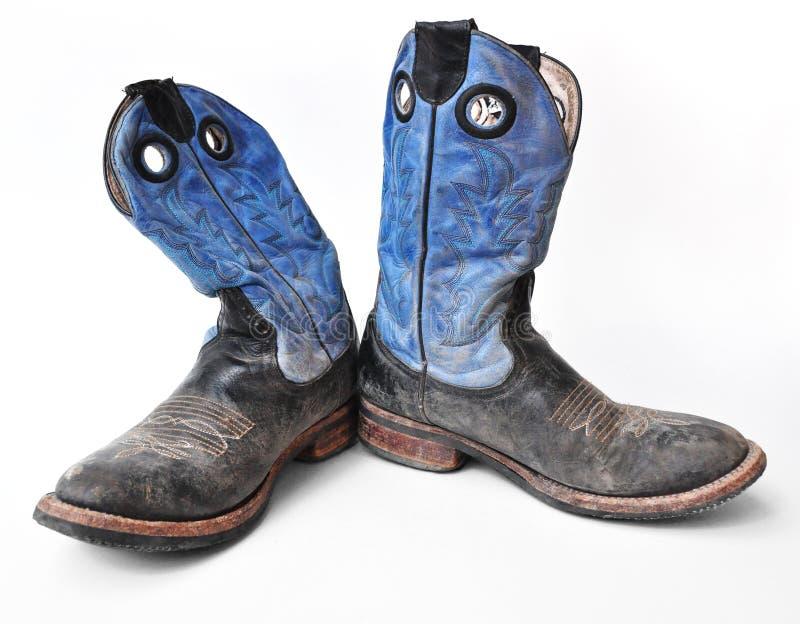 Um par de botas de vaqueiro azuis do rodeio fotografia de stock royalty free