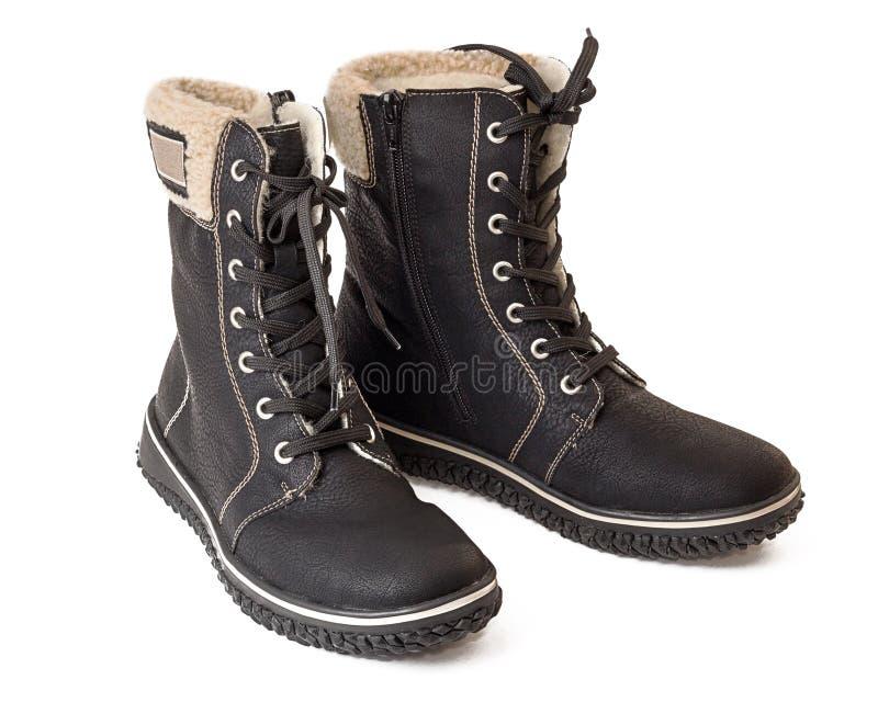 Um par de cor preta aquecida das botas isolada no branco fotografia de stock