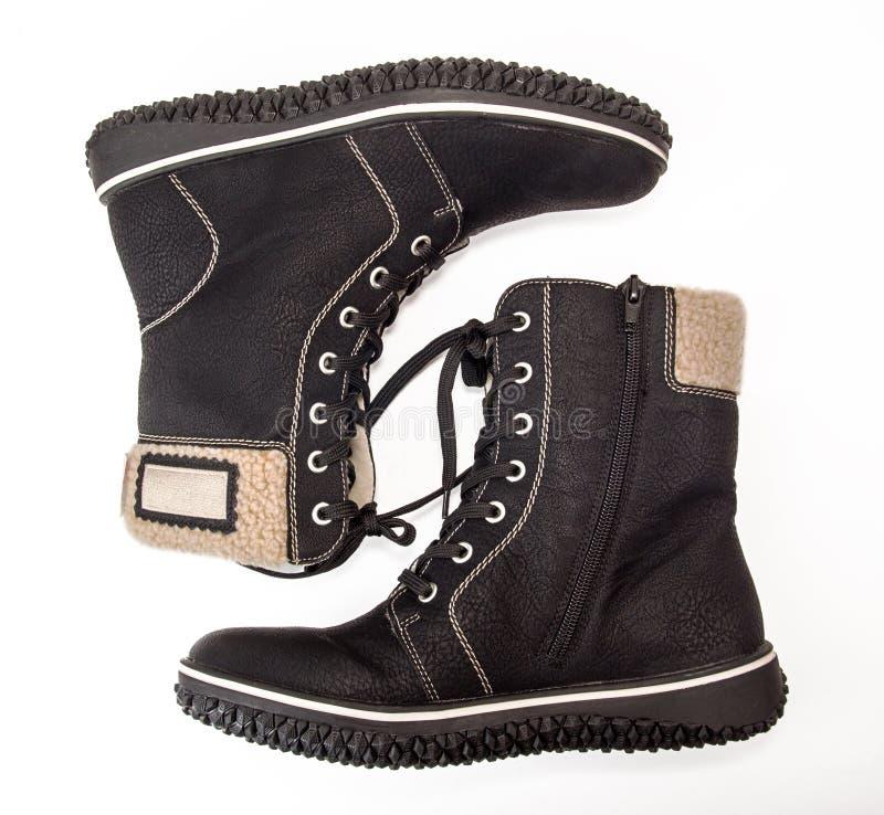 Um par de cor preta aquecida das botas isolada no branco imagem de stock royalty free
