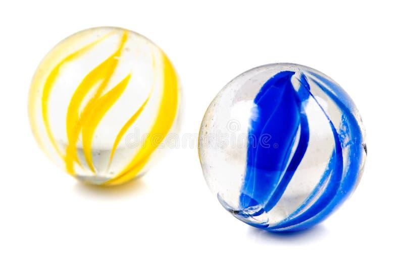 Um par de mármores de Cateye do vidro fotos de stock royalty free