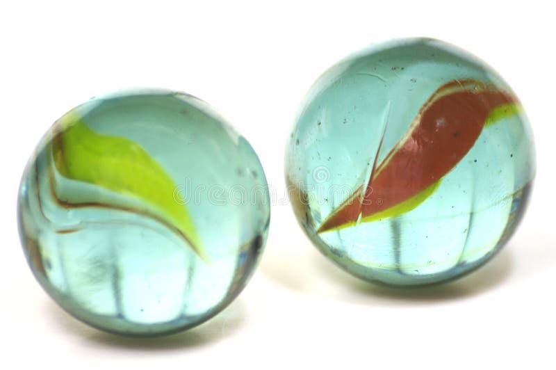 Um par de mármores do vidro fotografia de stock