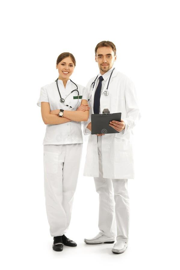 Um par doutores caucasianos novos no branco fotografia de stock royalty free