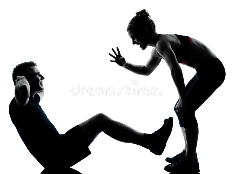 Um par equipa a mulher que exercita a aptidão do exercício foto de stock royalty free