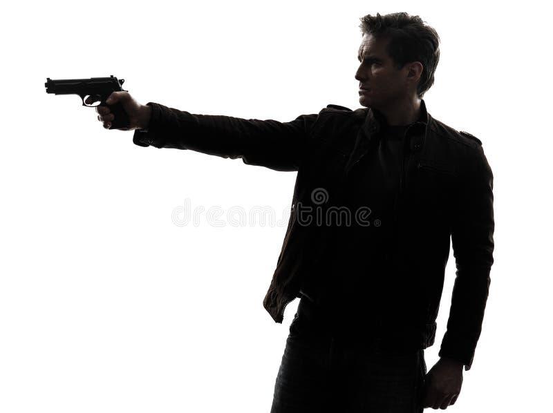 Polícia do assassino do homem que aponta a silhueta da arma imagem de stock