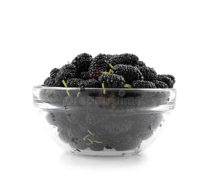 Um preto do mulberry está em um prato fotos de stock
