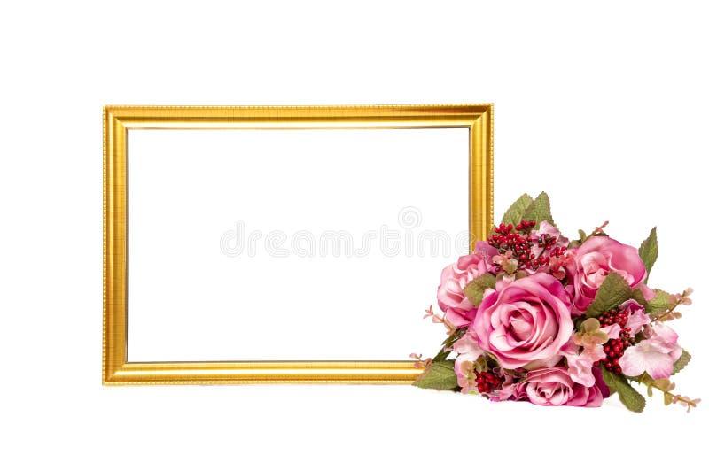um quadro de madeira e um ramalhete dourados das flores fotografia de stock
