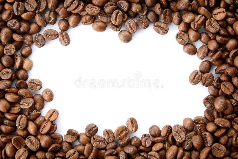 Um quadro dos feijões de café roasted com espaço vazio da cópia fotos de stock