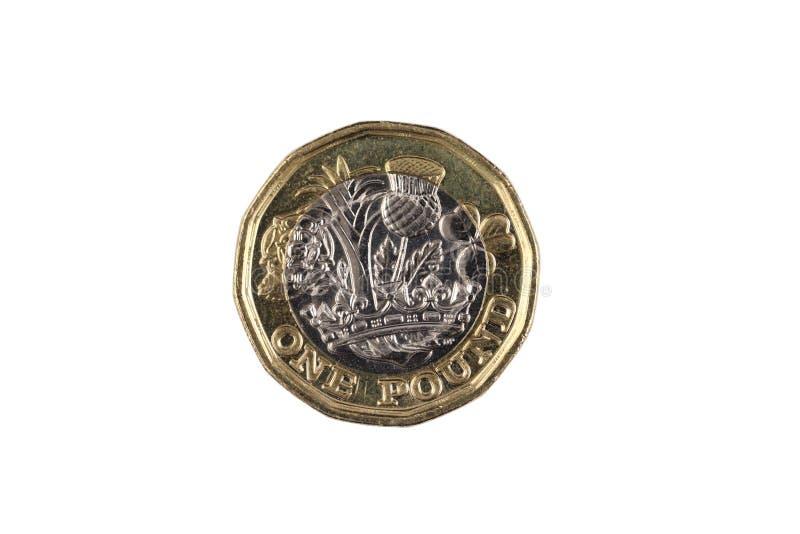 Um Reino Unido uma moeda de libra isolada em um fundo branco imagens de stock royalty free
