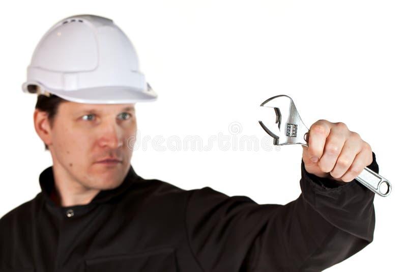 Uniforme e capacete de segurança vestindo do trabalhador manual fotos de stock