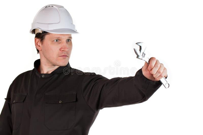 Uniforme e capacete de segurança vestindo do trabalhador manual foto de stock royalty free