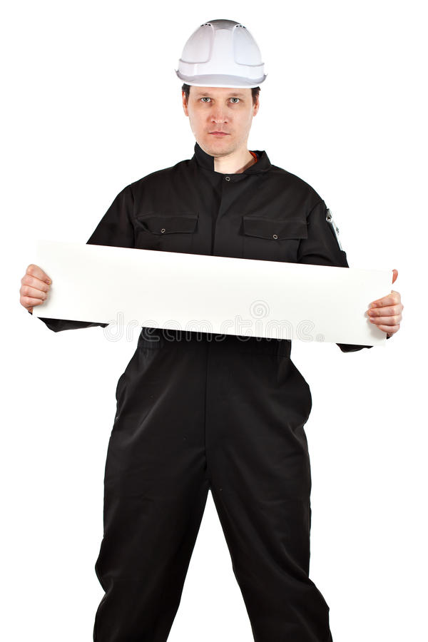Uniforme e capacete de segurança vestindo do trabalhador manual imagem de stock royalty free