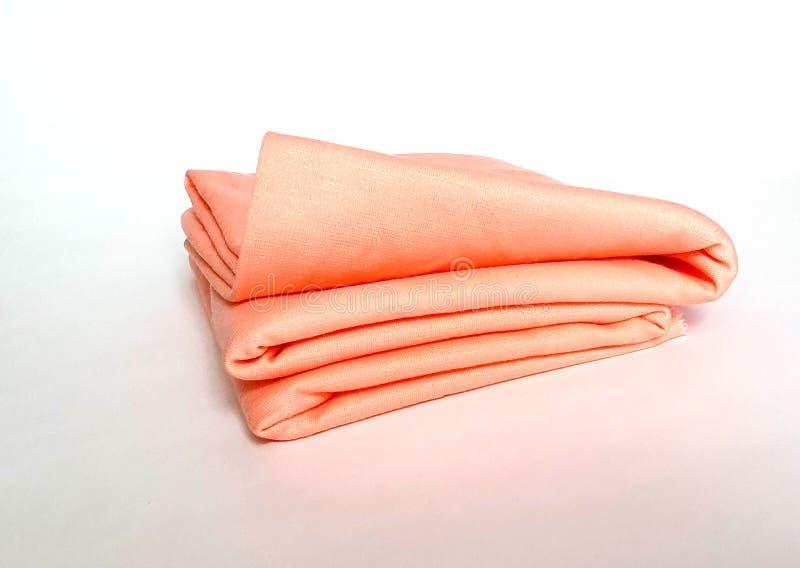 Um rolo da cor do pêssego, tecido de algodão macio fotos de stock