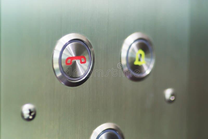 Um símbolo do elevador do sino de porta da imprensa imagens de stock