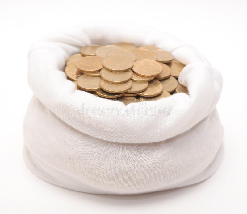 Um saco com moedas fotos de stock royalty free