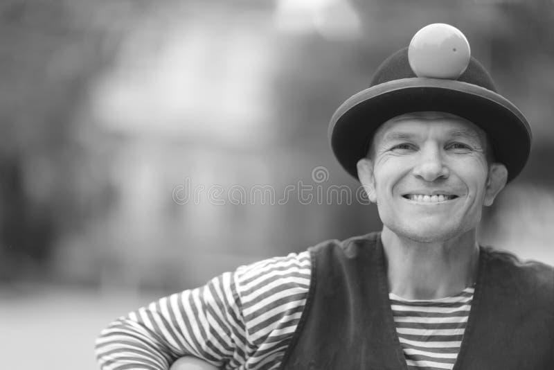Um sorriso feliz de um palhaço fotografia de stock