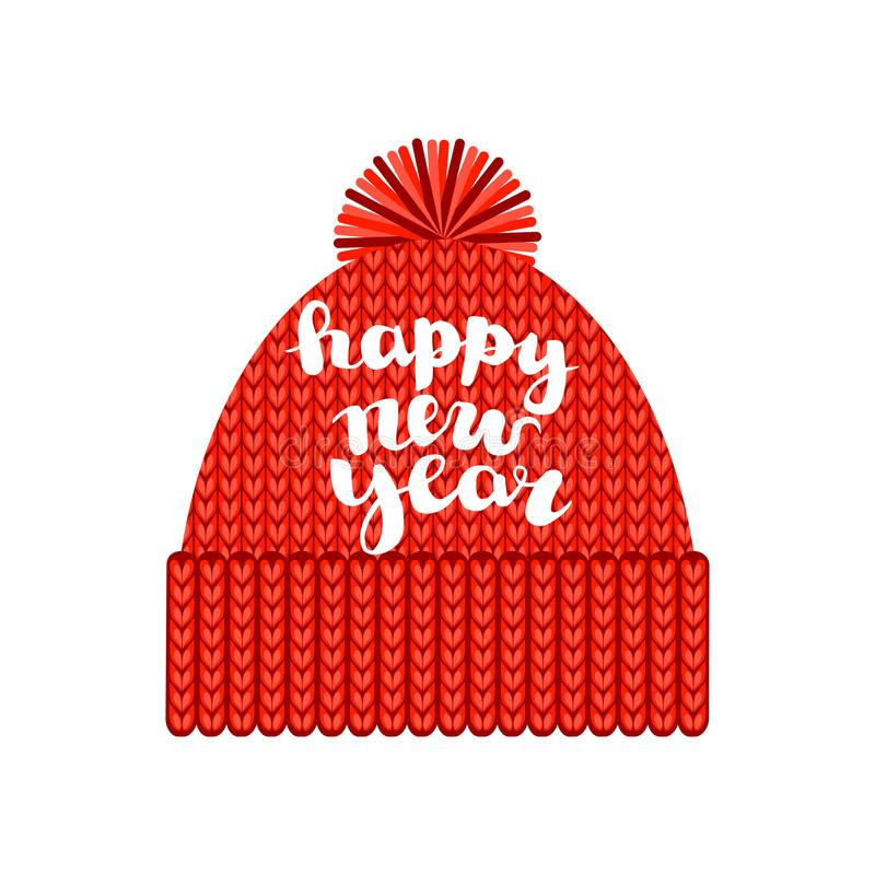 Um tampão vermelho feito malha com um pompom com a inscrição 'ano novo feliz ' Isolado em um fundo branco outono ou inverno a saz ilustração royalty free