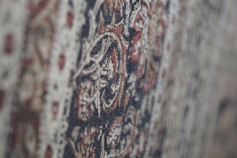 Um tapete mágico pela parede fotografia de stock