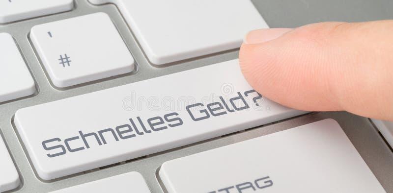 Um teclado com um botão etiquetado - dinheiro fácil - Schnelles castra alemão fotos de stock royalty free