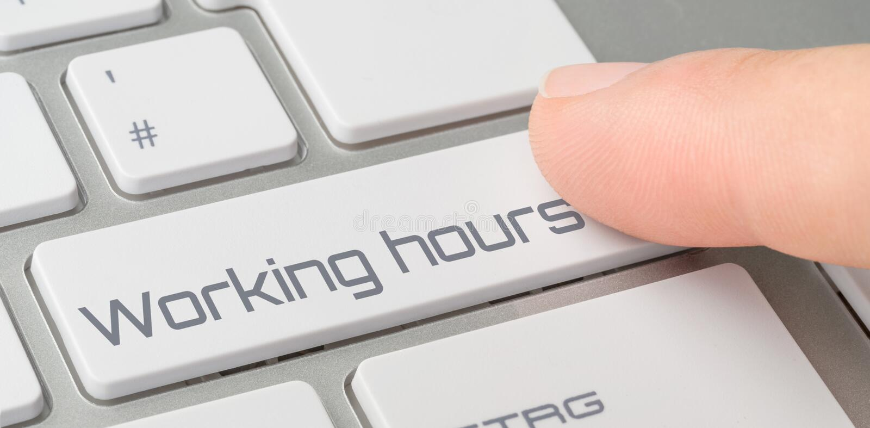 Um teclado com um botão etiquetado - horários laborais fotografia de stock