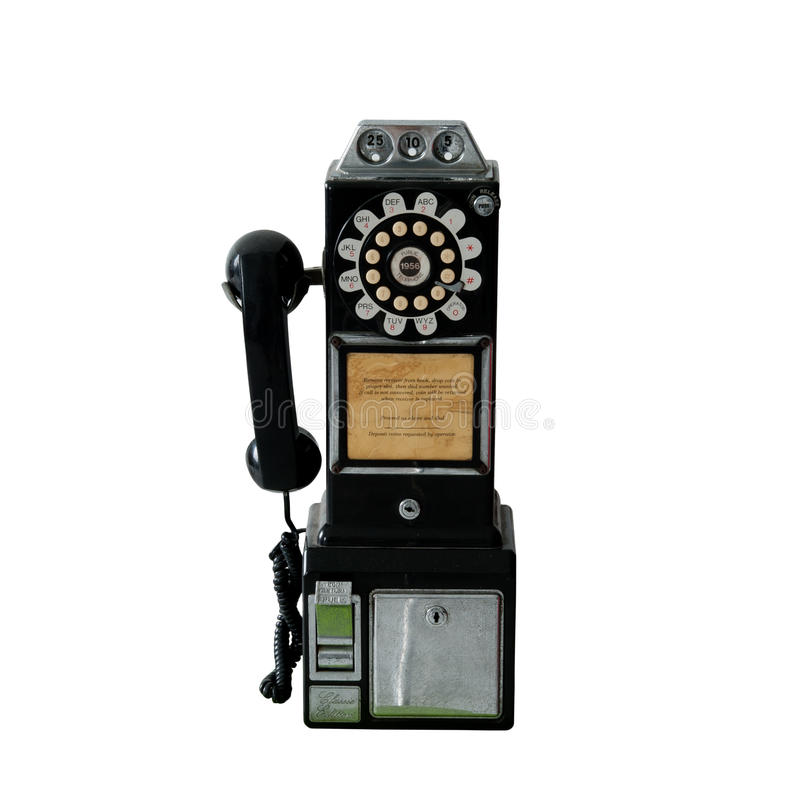 Um telefone de pagamento público do vintage velho isolado no branco fotografia de stock royalty free