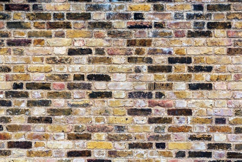 Um velho, resistido, modelado, parede de tijolo imagem de stock
