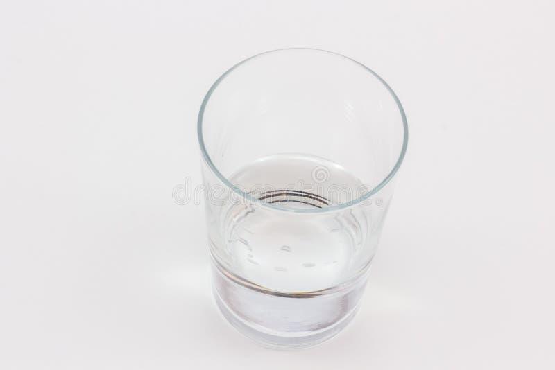 Um vidro com pouca água nela imagens de stock royalty free