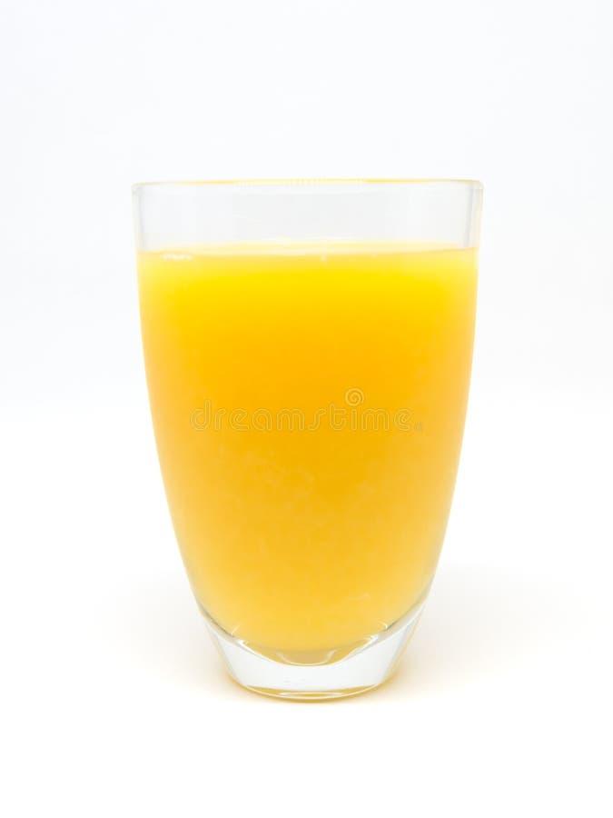 Um vidro do suco de laranja no fundo branco foto de stock royalty free