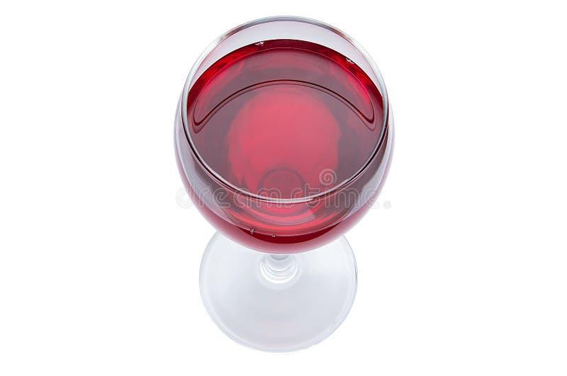 Um vidro do vinho tinto é uma vista superior Bebida alcoólica em um fundo branco fotografia de stock royalty free